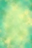 Mottled Canvas #1. Pale green mottled canvas with yellowish hot spot Royalty Free Stock Image