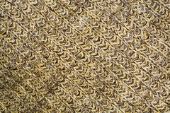 Mottled diagonal texture of the wool yellow brown knitted fabric Royalty Free Stock Photos