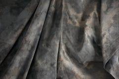 Mottled draped background cloth Stock Images