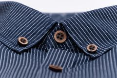 Mottled fabric denim style fine stuff soft material collar with buttons in brown royalty free stock images