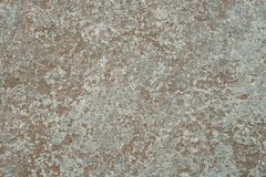 Mottled stone pattern. Closeup of limestone with a mottled pattern and rough texture Stock Image