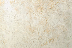 Mottled stucco stone structure background Stock Photo