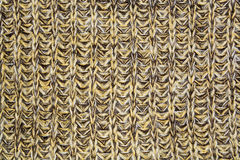 Mottled vertical texture of the wool yellow brown knitted fabric Stock Image