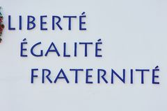 Motto of French Revolution on a white wall royalty free stock image