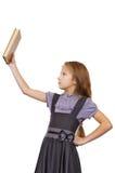 Motvillighet som läser en bok, gör läxa Arkivbild