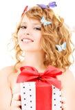 Motylia dziewczyna z prezentem Zdjęcie Royalty Free