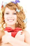 Motylia dziewczyna z prezentem Zdjęcia Stock