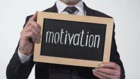 Motywacja pisać na blackboard w biznesmen rękach, dokształcanie webinar zbiory wideo