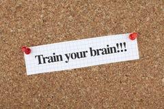 Motywacyjny notatka pociąg Twój mózg zdjęcia stock