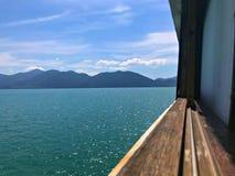 Mouchard par la fenêtre de bateau image libre de droits