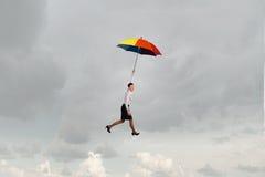 Mouche de femme sur le parapluie Images stock