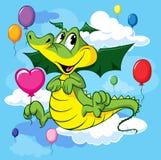 Mouche mignonne de dragon avec des ballons Photo libre de droits