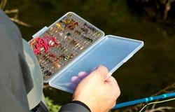 Mouche pour la truite flyfishing Photos stock