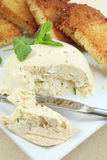 Moulded chicken meat pate vertical. A pate, moulded with gelatin, cream cheese herbs and chopped chicken breast, served with crispy toasted garlic bread Royalty Free Stock Photo