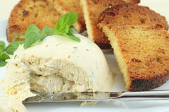 Moulded chicken pate and garlic toast. A pate, moulded with gelatin, cream cheese, herbs and chopped chicken breast, served with crispy toasted garlic bread Stock Image