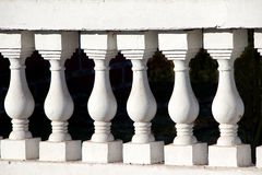 Moulded Concrete Pillars. Close-up of moulded concrete posts supporting slab of compound Royalty Free Stock Photo