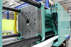 Moulding maskin för injektion Fotografering för Bildbyråer