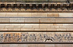 Mouldings on old sandstone building Stock Photos