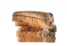 Mouldy bread isolated on white background. Stock Photo
