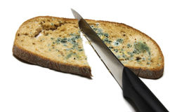 Mouldy bread slice in two. Slice of bread with mouldy and knife Stock Photos