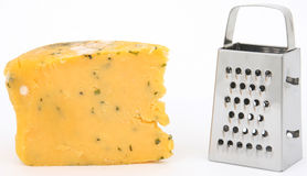 Mouldy cheese and grater. Mouldy Cheese covered in bacteria Stock Photography