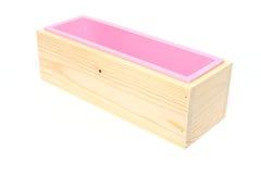 Moule de silicone pour le savon avec la boîte d'isolement sur le fond blanc Image stock