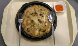 Moule frite par pot chaud Image stock