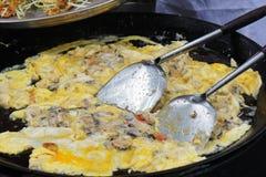 Moules frites dans la pâte lisse d'oeufs Photo stock