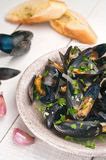Moules Marinieres - Mussels cooked with white wine sauce Stock Photo