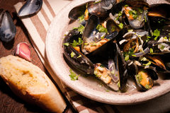Moules Marinieres - Mussels cooked with white wine sauce Stock Photos