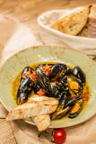 Moules Marinieres - Mussels cooked with white wine Stock Images