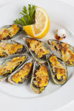 Moules sous le fromage Photographie stock