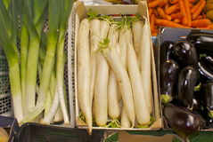 Mouli Leaks carrots and Aubergines. Boxes of vegetables on an open air vegetable stall Royalty Free Stock Images