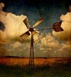 Moulin à vent dans le pré Photos stock