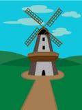 Moulin à vent entouré par les vallées vertes sur le DA ensoleillé Image libre de droits