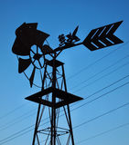Moulin à vent et lignes électriques Photo libre de droits