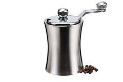 Moulin de poivre en métal et quelques grains Images stock