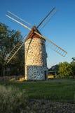 Moulin de vent au coucher du soleil Photo libre de droits
