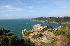 Moulin Huet Bay, Guernsey. Rocks and cliffs of coast at Moulin Huet Bay, Guernsey Stock Image