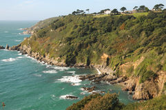 Moulin Huet Bay, Guernsey. Rocks and cliffs of coast at Moulin Huet Bay, Guernsey Royalty Free Stock Images