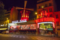 The Moulin Rouge cabaret at night. Paris, France - July 17 2014: The Moulin Rouge cabaret at night royalty free stock photography