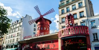 Moulin Rouge cabaret in Paris. Paris, France - May 18, 2014: The Moulin Rouge cabaret building in Paris royalty free stock photography