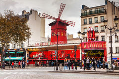 The Moulin Rouge cabaret in Paris. PARIS - OCTOBER 10: The Moulin Rouge cabaret on October 10, 2014 in Paris, France. Moulin Rouge is best known as the spiritual stock photography