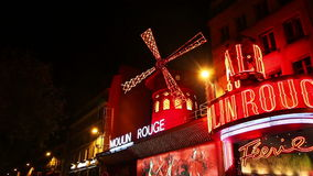 The Moulin Rouge cabaret in Paris stock footage