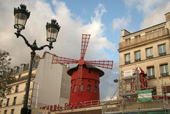 The Moulin Rouge - a famous cabaret, located in Paris district of Pigalle on Boulevard de Clichy Royalty Free Stock Photo