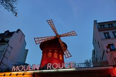 Moulin Rouge is the famous cabaret in Paris. PARIS, FRANCE -APRIL 7, 2018: Moulin Rouge is the famous cabaret in the city royalty free stock photos