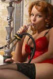Moulin Rouge girl smoking a hookah Royalty Free Stock Images