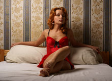 Moulin Rouge lady on a luxurious bed Stock Photo