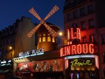Moulin Rouge Neon Light Sign on Concrete Building Royalty Free Stock Photography