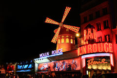 The Moulin Rouge by night Stock Image